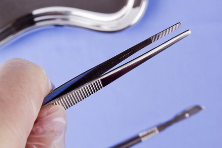 Professional surgical instrument in hand physician. Operating. Stock Photo - 26043036