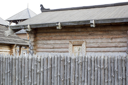 Architecture of ancient Russia - a log house and a stockade. photo
