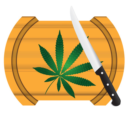 Cooking marijuana, Cannabis leaf on a board with a knife.