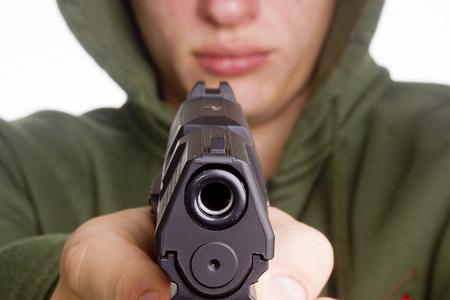 Man threatened with a gun. Control of Firearms. Stock Photo - 27783057