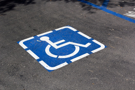 Signal parking space for disabled parking. Road markings. Archivio Fotografico