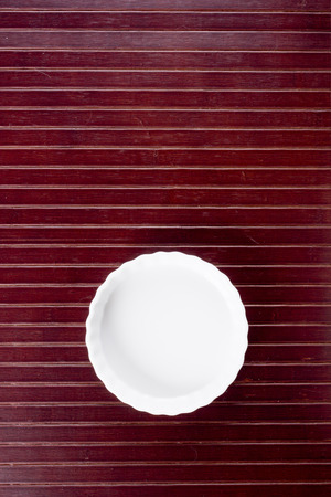 cookware: Ceramic dish on wooden kitchen litter. Cookware. Stock Photo