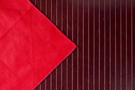 Red napkin with wooden background. Basis servings.