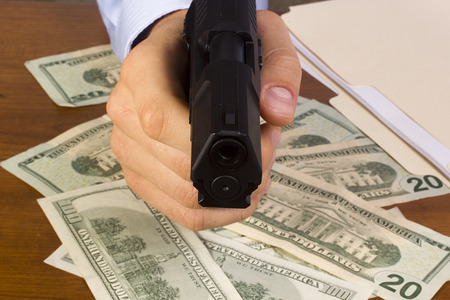 Robbery with the use of a gun. Stock Photo
