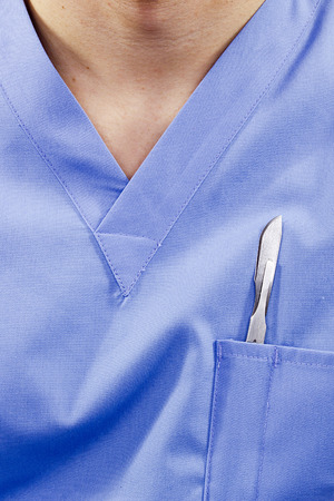 Surgical scalpel in his pocket uniforms. Medicine. Stock Photo - 27522834