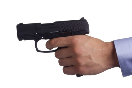 Man threatened with a gun. Control of Firearms. Stock Photo - 27673302