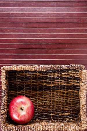 meshwork: Background with a rectangular wicker basket and an apple. Cooking utensils.