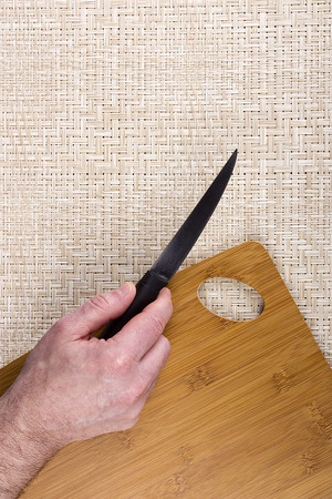 Kitchen knife on a table with a cutting board. photo