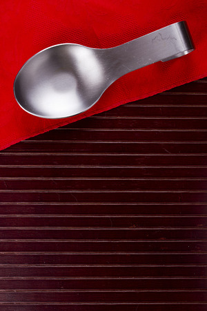 Kitchen utensils - spoon rack soiled spoons and forks. Stock Photo