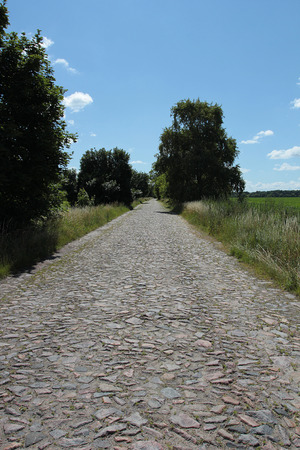 Plot road surface of rough stones. Secondary roads.