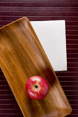 Background with apple and kitchen equipment.