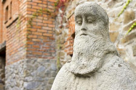 Stone sculpture of sage in a historic complex Radomishl Zhytomyr Oblast, Ukraine, summer 2014. photo