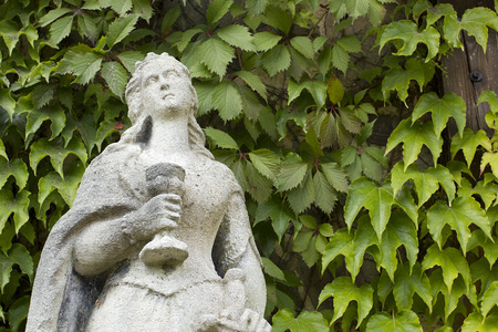 Stone sculpture of a woman with a cup and a sword in the historical complex Radomishl Zhytomyr Oblast, Ukraine, summer 2014. photo