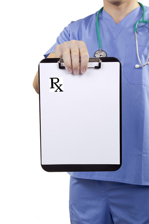 A doctor in blue uniform holding a clipboard with Medical prescriptions. photo