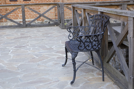 timber bench seat: Antique carved chair made of steel for use in the yard.