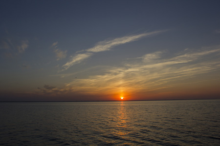 eventide: Summer sunset on the sea in calm weather. Stock Photo