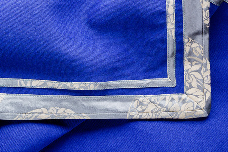 Blue fabric trimmed along the edge of ornament.