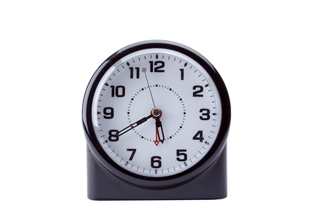 Alarm Clock Appliance modern, ergonomic shape with the traditional dial and arrows, isolated on white background.