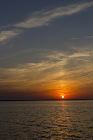 eventide: Sunset over the sea in calm weather. Stock Photo