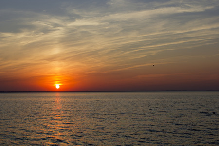 eventide: Sunset over the sea in calm weather. Editorial