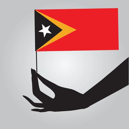 east: Flag of East Timor in a female hand. Vector illustration. Illustration