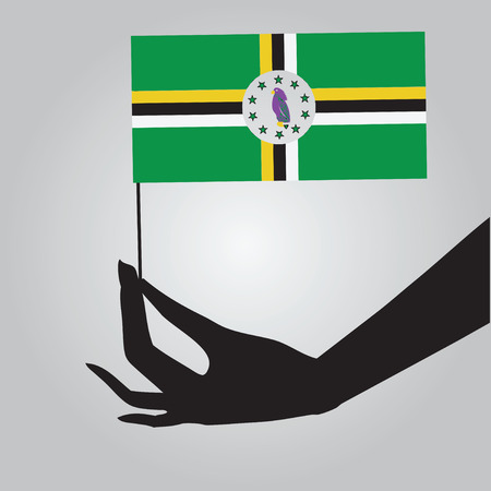 Flag of Dominica in a female hand. Vector illustration.