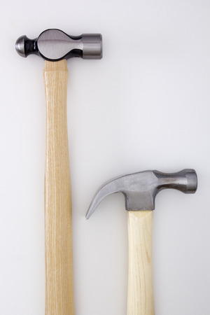 Two industrial hammer with wooden handles. photo