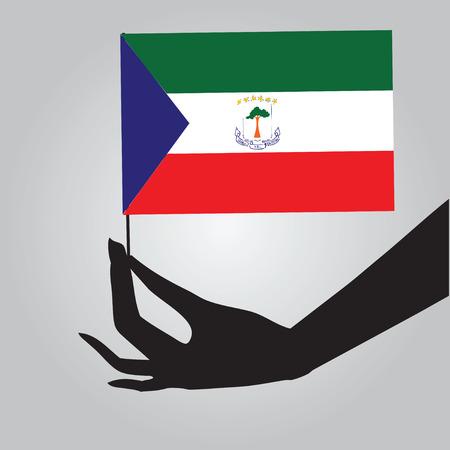 equatorial guinea: Flag of Equatorial Guinea in a female hand.