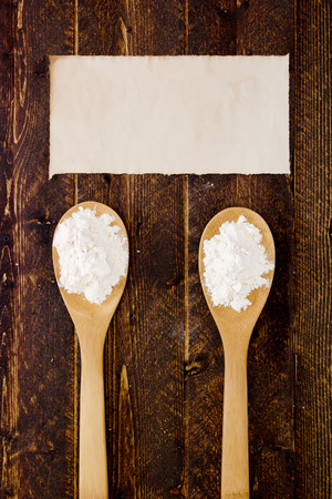 starch: Wooden kitchen spoon with flour and starch. Stock Photo