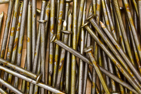 lubrication: Construction nails lubrication for long-term storage to pour out on the table.