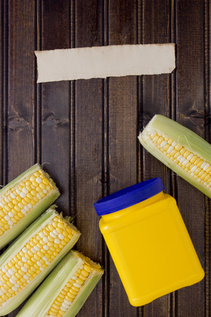 tupperware: Corn on the cob and plastic packaging for the starch. Stock Photo