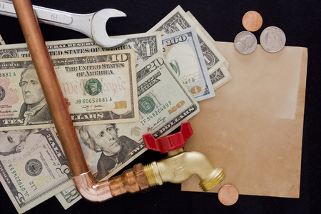 utility payments: Financial expenses for repair waterpipe as utility payments. Stock Photo