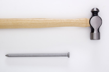 housebuilding: Building a hammer and a large nail.