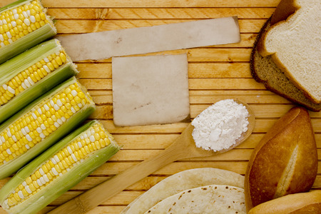 starch: Corn starch with corn on the cob and bread. Stock Photo