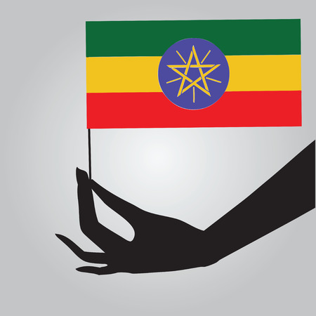 Flag of Ethiopia in a female hand. Vector illustration. Vector