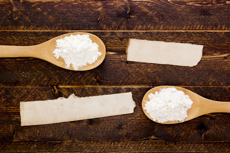 explanatory: Cooking spoon with flour and starch with an explanatory note. Stock Photo