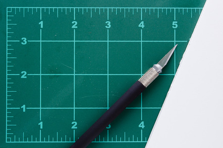 grid paper: Mat with markings for cutting and a special knife.