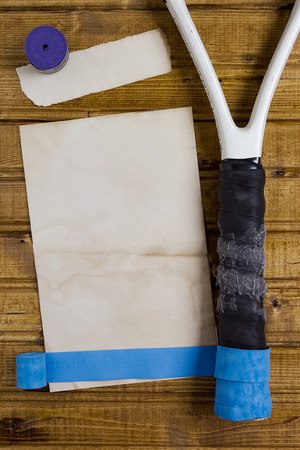 Repair tape to restore the handle of a tennis racket. Stock Photo