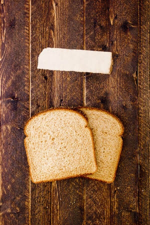describe: Poster with two slices of bread and a piece of paper to describe.