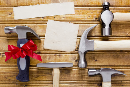 carpentry cartoon: Gift set of different hammers and paper. Stock Photo
