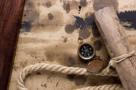 rolled scroll: Compass and marine rope with a rolled scroll.