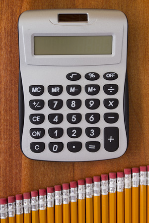 compiled: Calculator and pencil set compiled in a graph.