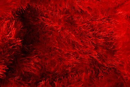 hilo rojo: Tejidos de hilados recortadas. Fondo rojo.