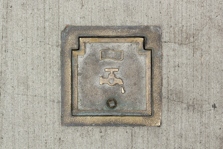 the hatch: San Diego, California, USA, March 15, 2015. Industrial hatch in the road surface water system. Stock Photo