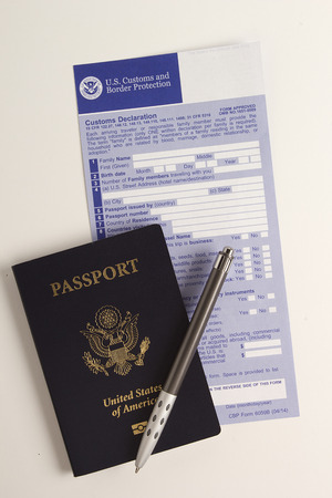 declaration: Customs declaration form with a passport, visa for passing control. Stock Photo