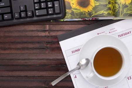 A cup of tea on the office calendar. Stock Photo