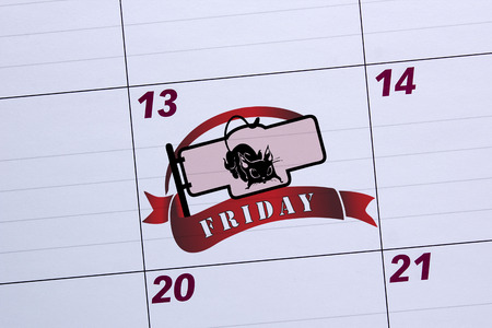 superstition: Office calendar marked Friday the 13th. Days of failure. Stock Photo
