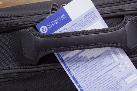 declaration: Customs declaration on a road suitcase, passing visa control. Stock Photo
