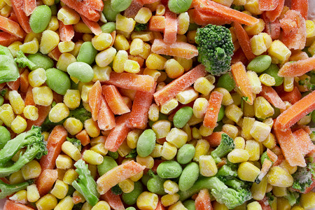 Frozen vegetables. Frozen vegetable mixture of carrots, corn and peas. Stock Photo