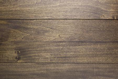 Wooden background of the floorboard dark brown.